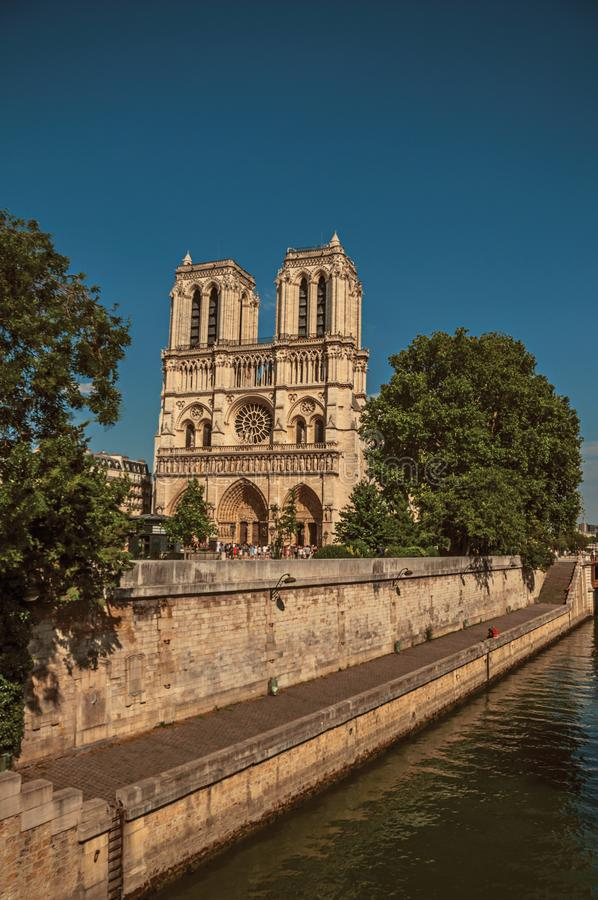 """Seine River and Notre-Dame Cathedral in Paris. People, tree-lined Seine River and gothic Notre-Dame Cathedral at Paris. Known as the """"City of stock photo"""