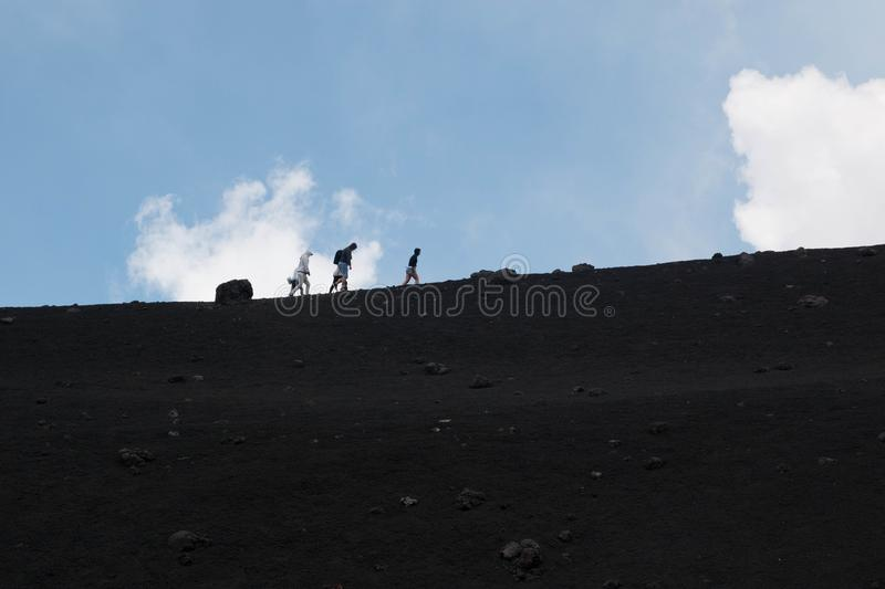 People trekking on Etna volcano, Sicily. royalty free stock photography