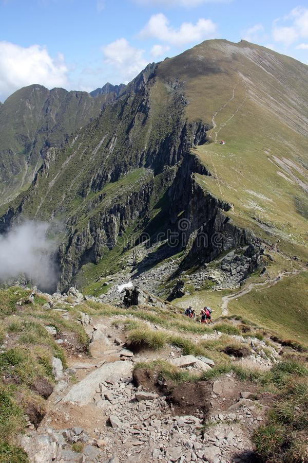 People trekking in the mountains. Near Moldoveanu Peek in Fagaras mountains royalty free stock images