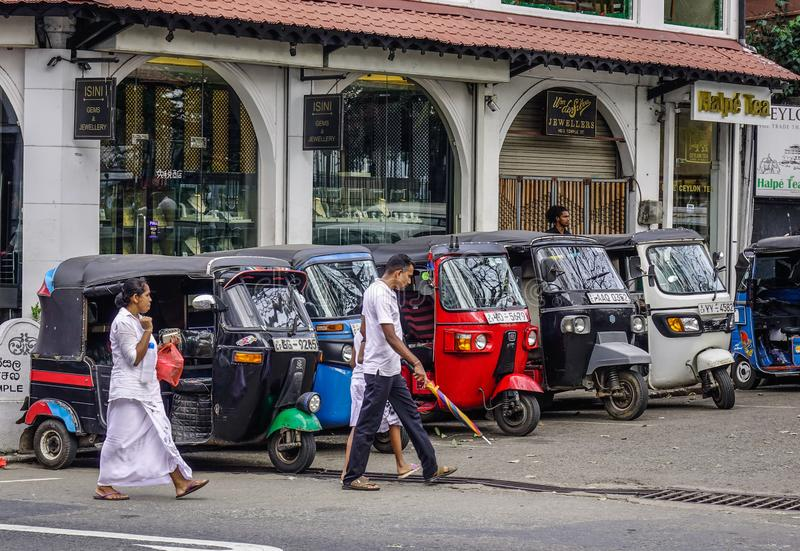 People and tuk tuk taxis on street royalty free stock photo