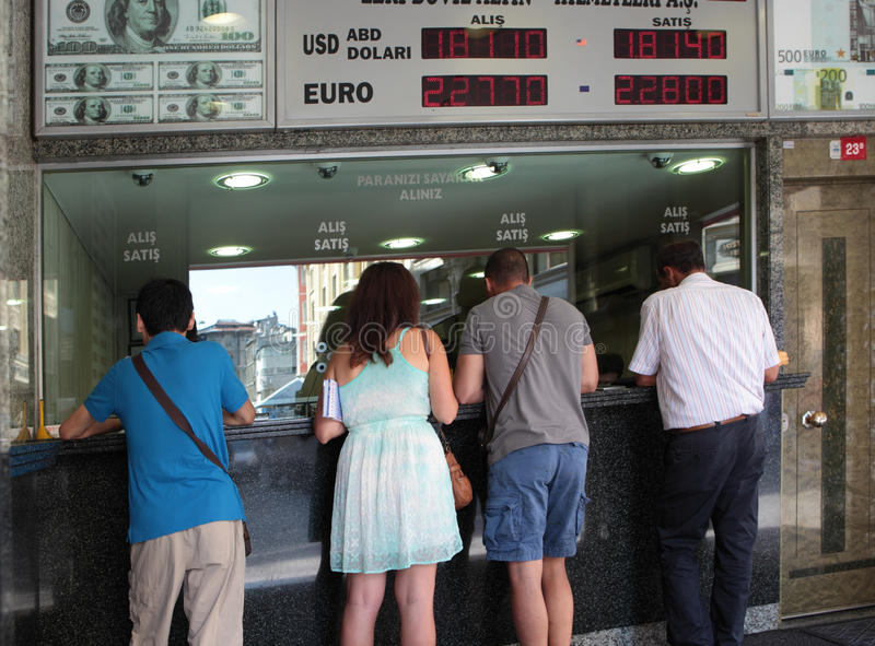 People in the Turkish change office. Istanbul, Turkey - June 23, 2012: People change money in the currency exchange office on the crossroad of Findikci Remzi royalty free stock photo