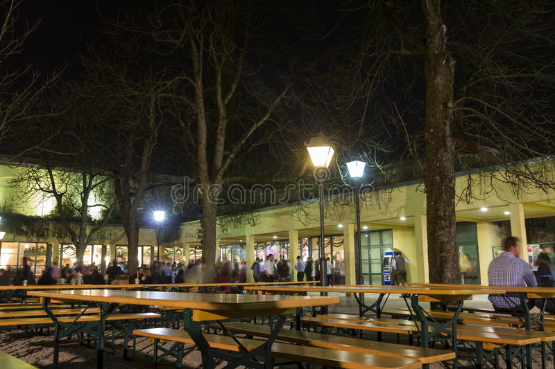 People at the typical german beer garden at night stock photos