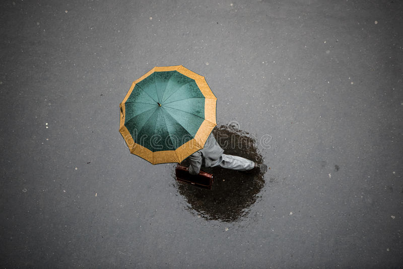 People with Umbrella. People in the Rain with Umbrella, Bird's eye view royalty free stock photography