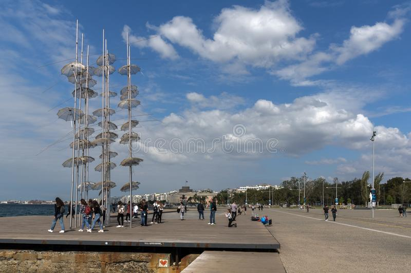 People under Umbrellas sculpture in of of city of Thessaloniki, Central Macedonia, Gre. THESSALONIKI, GREECE - SEPTEMBER 30, 2017: People under Umbrellas royalty free stock photography