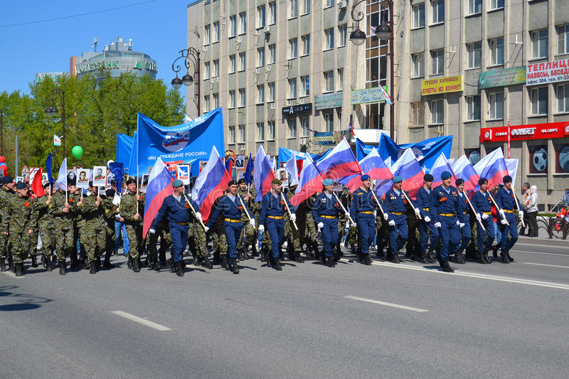 People in uniform with flags of the Russian Federation take part. In demonstration in honor of the Victory Day on May 9, 2016. Tyumen, Russia stock photo