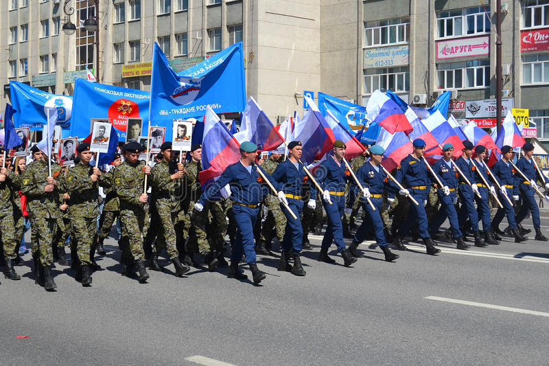 People in uniform with flags of the Russian Federation take part. In demonstration in honor of the Victory Day on May 9, 2016. Tyumen, Russia royalty free stock photo