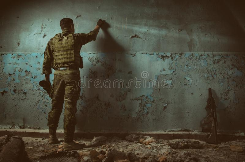 The people in uniform with weapons in the ruins royalty free stock photo