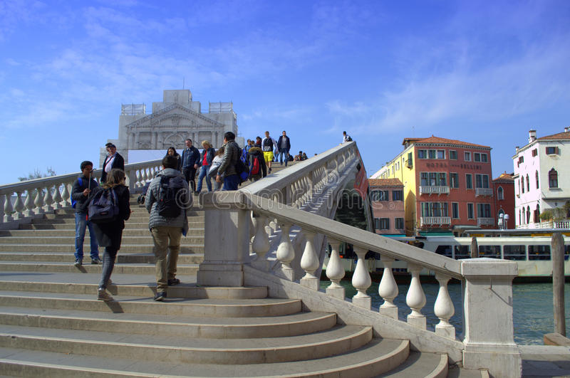 People up the bridge stairs, Venice Italy. People tripping beautiful bridge over the Grand Canal.Venice stock image