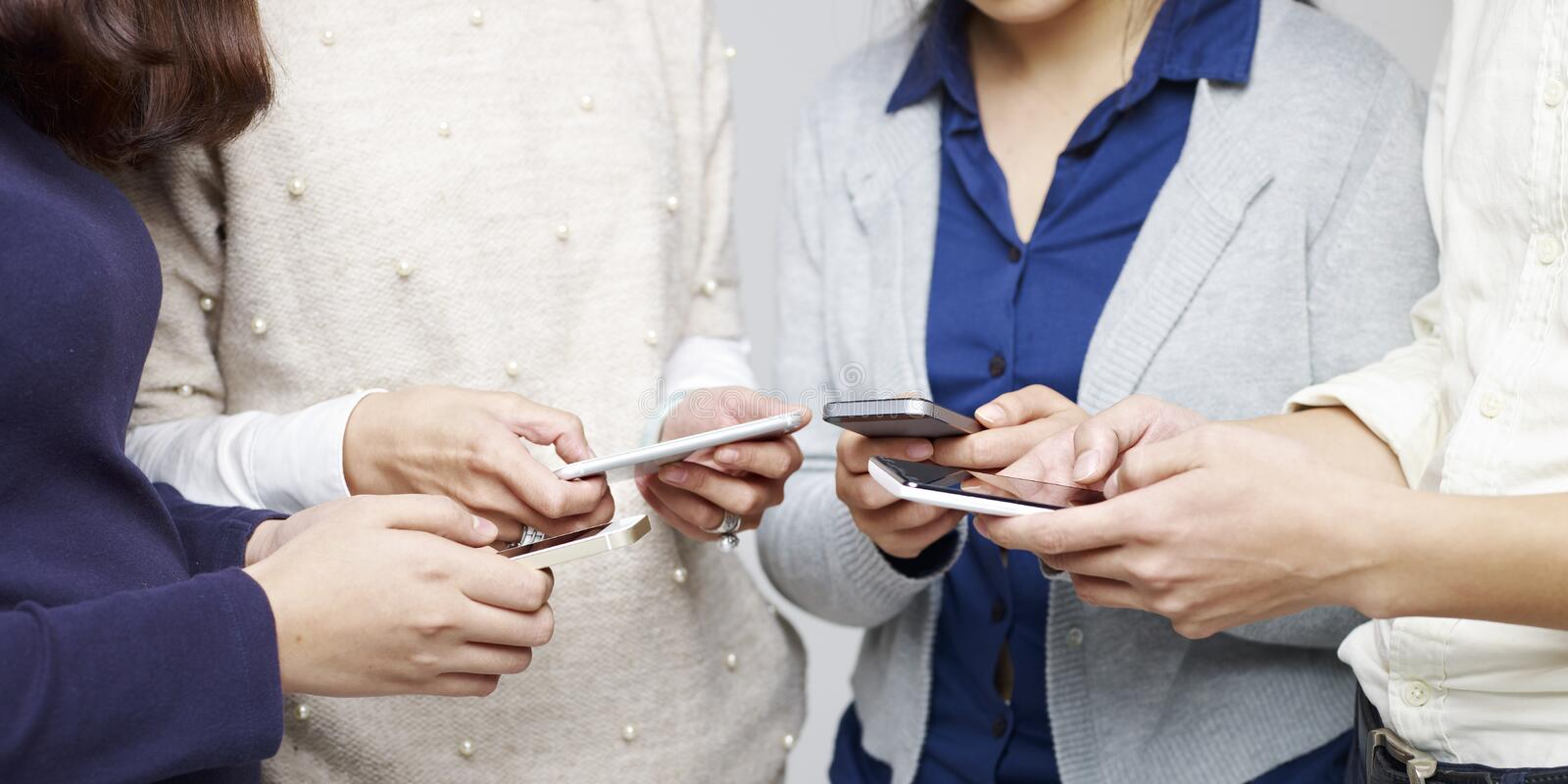 People using cellphone royalty free stock photo