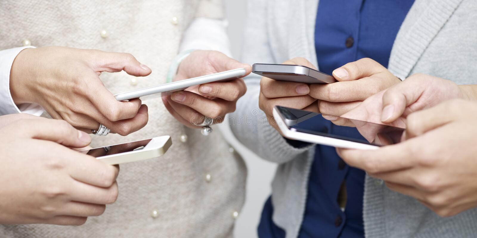 People using cellphone. Small group of people using cellphones together