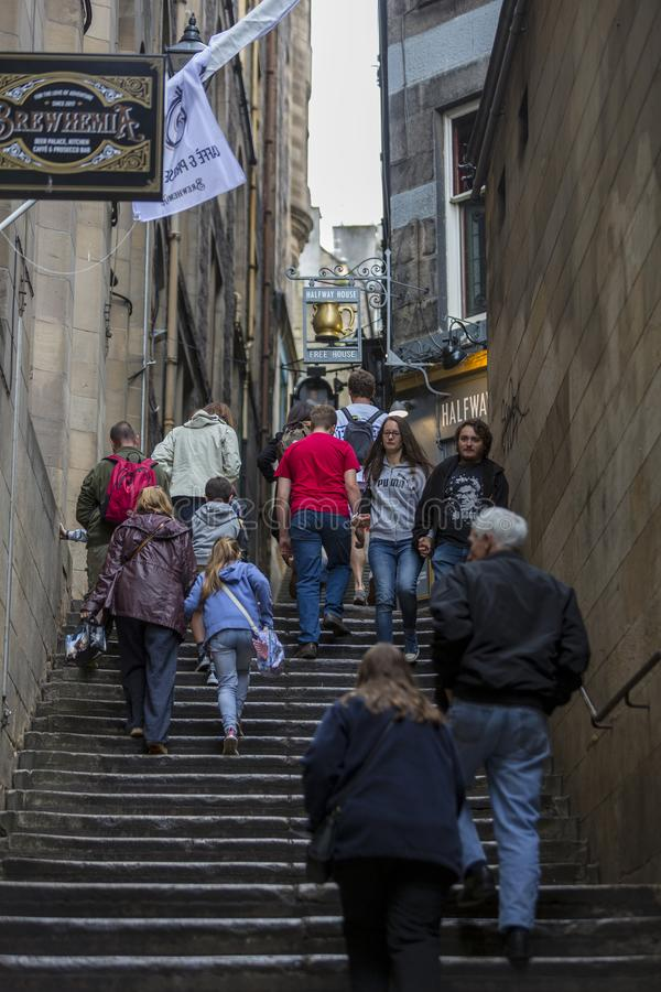 People using a close alley during the Edinburgh Fringe Festival stock photography