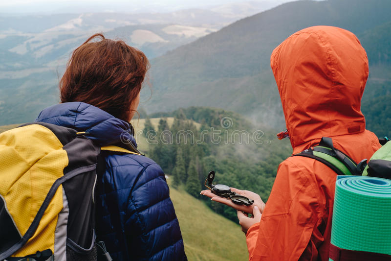 Download People Using Compass In Mountain Stock Image - Image: 83704683