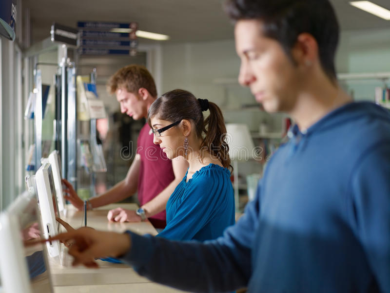 People using pc in library stock photo