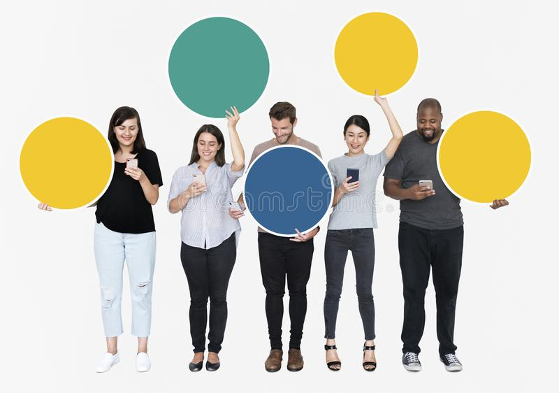 People using their phones holding empty circles stock photo