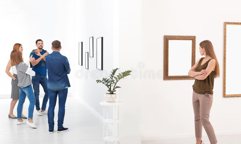 People viewing exposition stock images