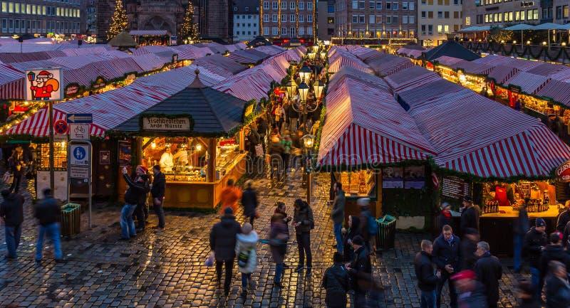 People visit Christmas Market in evening- Nuremberg, Germany royalty free stock photos