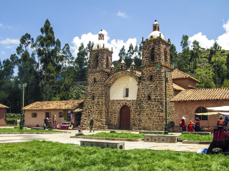 People visit the church San Pedro de Cacha in Raqchi. RAQCHI, PERU - JAN 19, 2015: people visit the church San Pedro de Cacha in Raqchi, Peru. The church of royalty free stock image