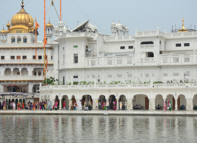 People visit the Golden temple with the lake in Amritsar, India royalty free stock images