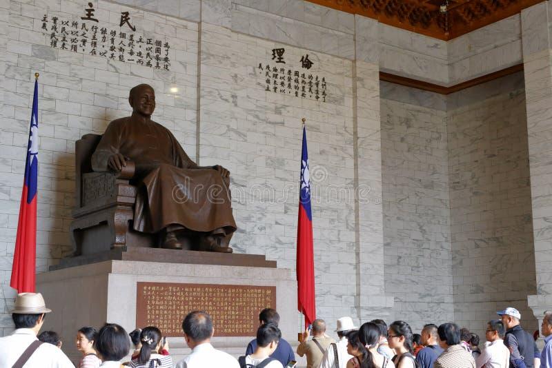 People visit jiangjieshi statue. Chiang kai - shek seated figure in jiang jieshi memorial hall in taipei city stock photos