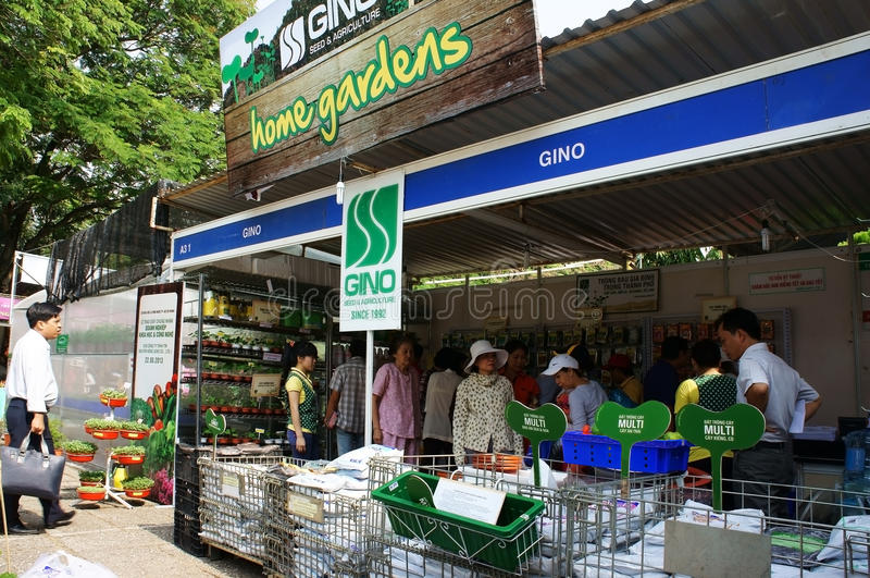 People visit pavilion at hitech agriculture fair. HO CHI MINH CITY, VIET NAM- DEC 12: Crowd of people visit pavilion that sale material for home garden model at stock image