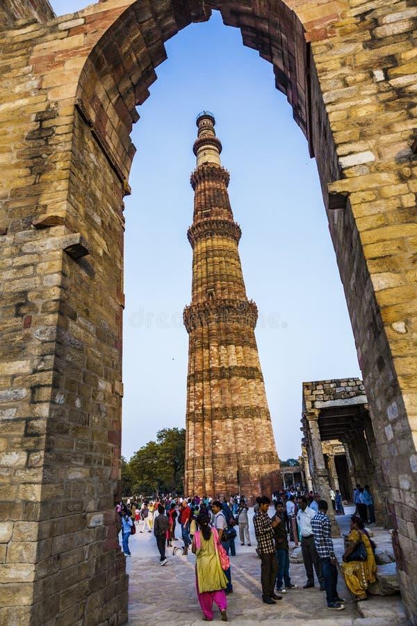 People visit Qutb Minar, Delhi, the worlds tallest brick built m. DELHI, INDIA - NOV 13, 2011: people visit Qutb Minar, Delhi, the worlds tallest brick built stock photography