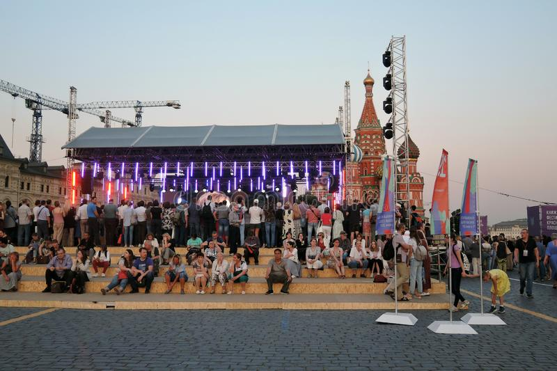 People visit The Red Square Book Fair in Moscow. stock photo