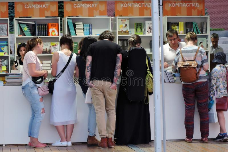 People visit The Red Square Book Fair in Moscow. royalty free stock image