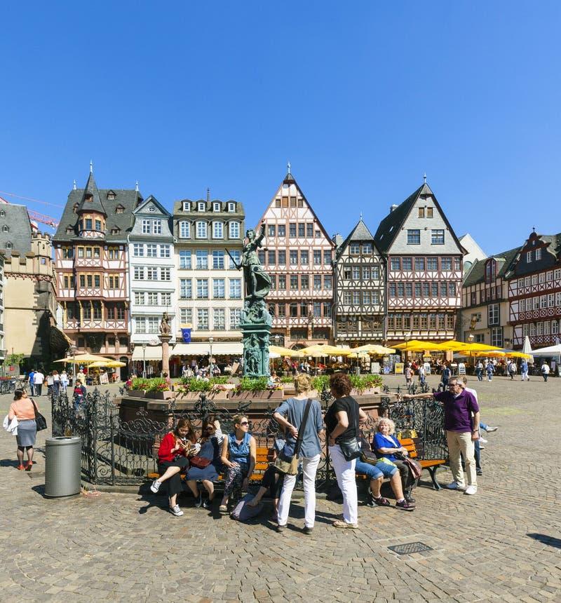 People visit Romerberg (Romerplatz) with old buildings in Frank royalty free stock photos