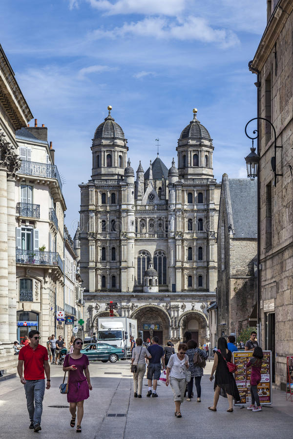 People visit the Saint-Michel church in Dijon. DIJON, FRANCE - SEP 3, 2016: people visit the Saint-Michel church in Dijon, France. Dijon is a city in eastern royalty free stock images