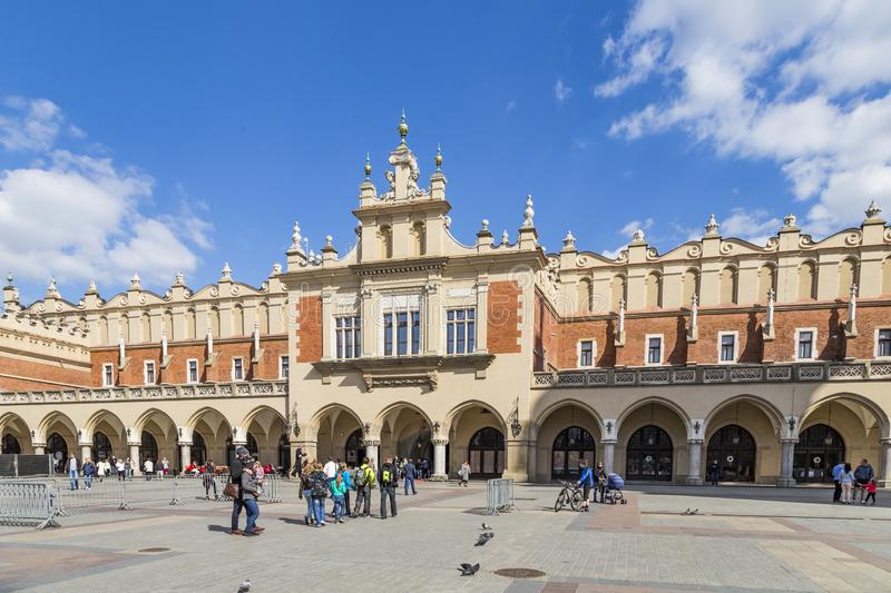 people visit Sukiennice on The Main Market Square in Krakow, Poland royalty free stock photos