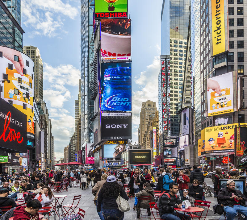 People visit Times Square, featured with Broadway Theaters and h. NEW YORK, USA - OCT 21, 2015: people visit Times Square, featured with Broadway Theaters and royalty free stock image