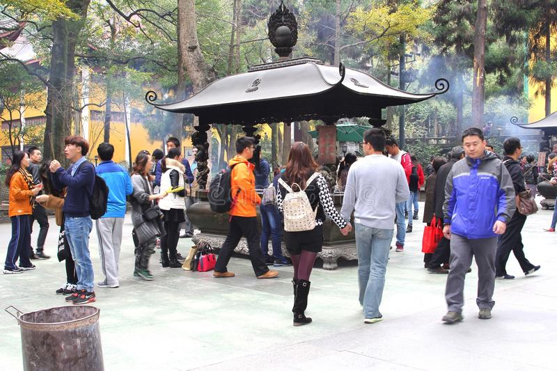 People are visiting the Confucian Lingyin temple, Hangzhou, China. People are burning incense and are visiting the Buddhist Lingyin temple in Hangzou, province stock images