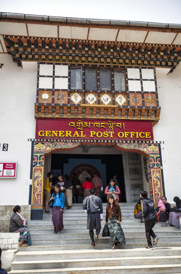 People visiting the busy General Post Office building at capital city Thimpu Royal Govt of Bhutan. Visitor can have their own image printed into their postal stock photos