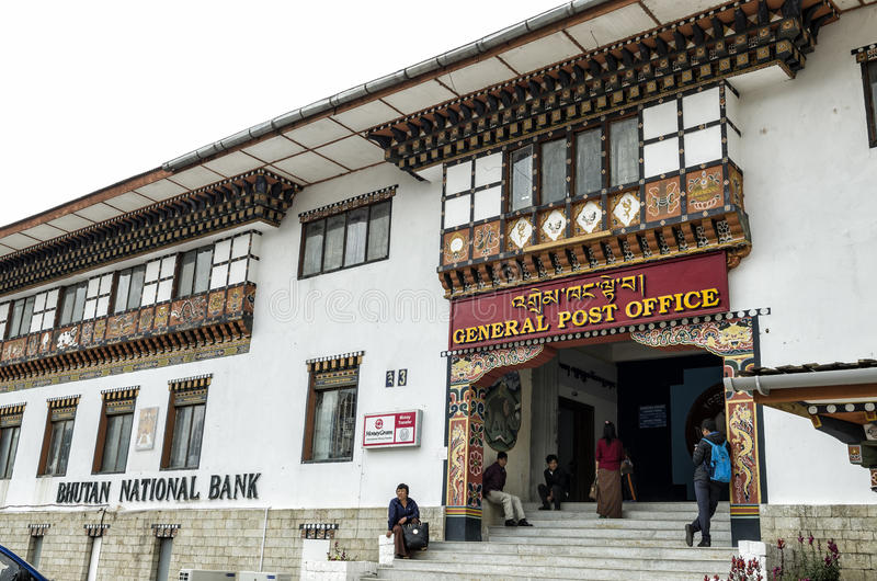 People visiting the busy General Post Office building at capital city Thimpu Royal Govt of Bhutan. Visitor can have their own image printed into their postal stock image