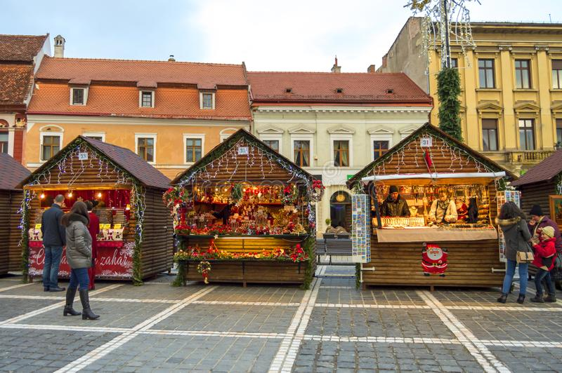 People visiting the Christmas market in the center of Brasov stock photos