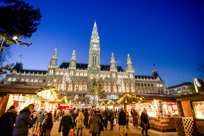 People visiting the Christmas Market in Vienna. VIENNA, AUSTRIA - 6 DECEMBER 2016: People visiting the Christmas Market in Vienna park and City Hall Rathaus stock image