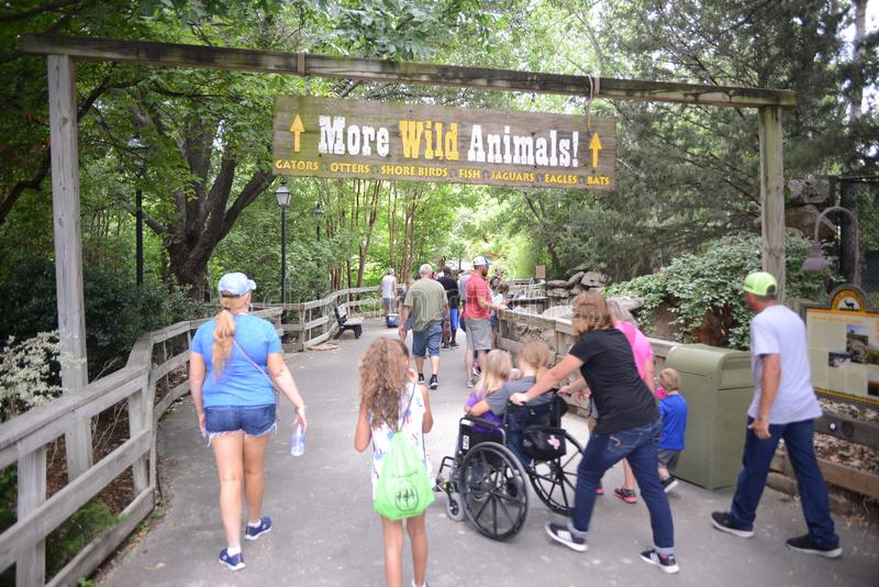 People Visiting the Fort Worth Zoo, Fort Worth, Texas. The Fort Worth Zoo is a zoo in Fort Worth, Texas, United States, that was founded in 1909 with one lion stock photo