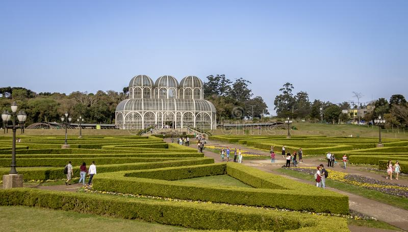 People visiting the greenhouse of Curitiba Botanical Garden - Curitiba, Parana, Brazil. CURITIBA, BRAZIL - Aug 27, 2017: People visiting the greenhouse of royalty free stock image