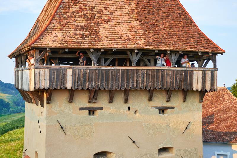 People visiting a lookout tower in the fortified church of Alma Vii village, during a brunch and wine tasting event. Alma Vii, Transylvania, Romania - July 27 stock photography