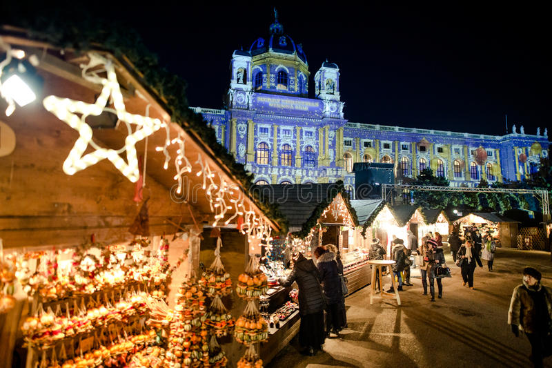 People visiting Maria Theresa Christmas Market Vienna. VIENNA, AUSTRIA - 6 DECEMBER 2016: People visiting Maria Theresa Square Platz Christmas Market. Focus in stock image