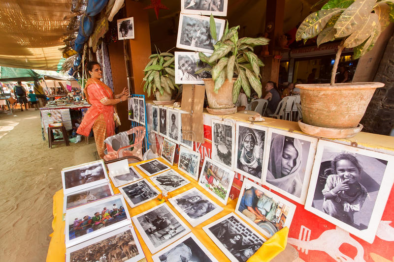 People visiting popular indian cafe with photo exhibition about rural life stock photo
