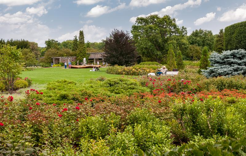 People visiting the Rose Garden with Rose Petal Fountain at Chicago Botanic Garden, Glencoe, Illinois, USA. Glencoe, Illinois, United States - August 20, 2014 stock photo