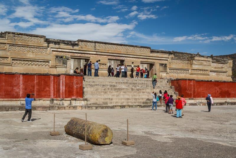 People visiting ruins. MITLA / MEXICO - JANUARY 2014: People visiting ruins of the pre-hispanic Zapotec town Mitla, Puebla, Mexico stock photos