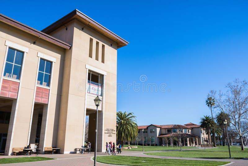 People visiting Santa Clara University campus. February 17, 2018 Santa Clara / CA / USA - People visiting Santa Clara University campus on a sunny day, south San royalty free stock photos