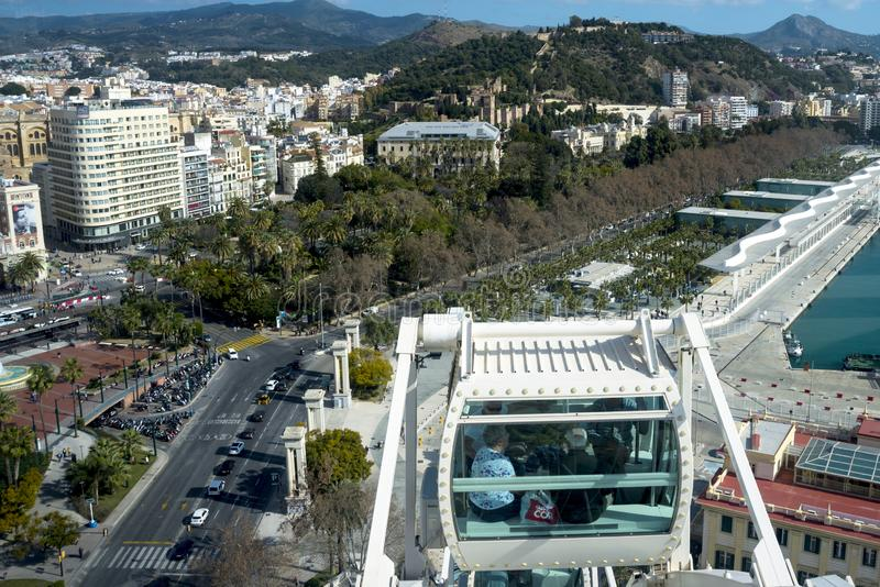 People visiting the Spanish city of Malaga from the cab of the Ferris wheel. Travel older couples. stock photography