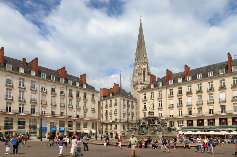 Place Royale de Nantes. People visiting town square Place Royale in the shopping center of Nantes, France, on a summer day with the Basilique Saint-Nicolas de stock photo
