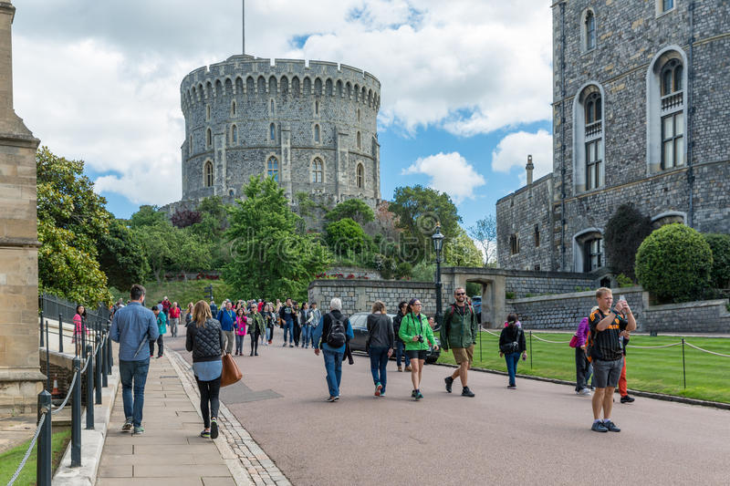 People visiting Windsor Castle, country house queen of England. WINDSOR, ENGLAND - JUNE 09, 2017: People visiting Windsor Castle, country house queen of England royalty free stock photo