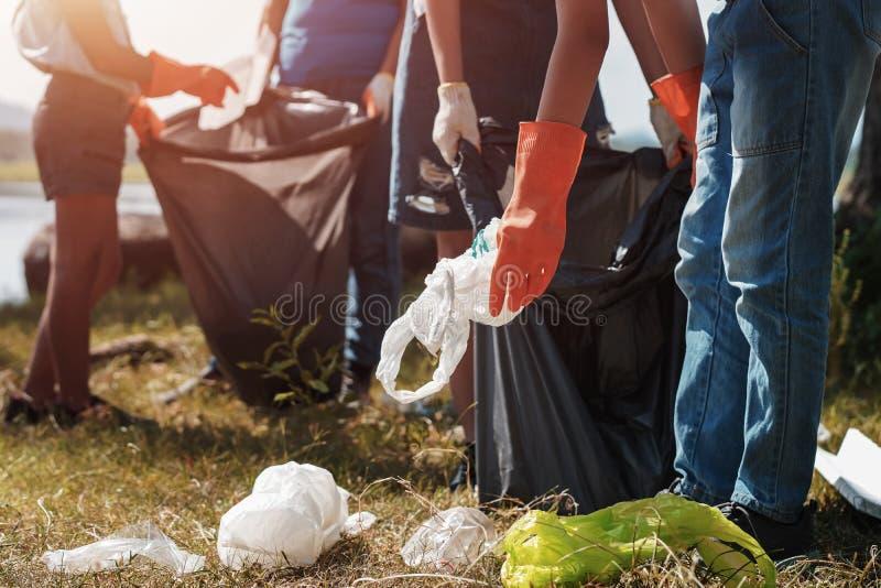 People volunteer help garbage collection at park. Trash, up, litter, volunteering, waste, picking, green, plastic, food, rubbish, bin, environment, ecology royalty free stock photos
