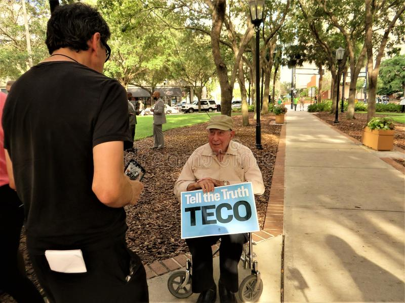 People vs TECO protest Tampa, Florida. Elderly disabled man attending protest sponsored jointly by Sierra Club and Extinction Rebellion Tampa Bay to protest stock image