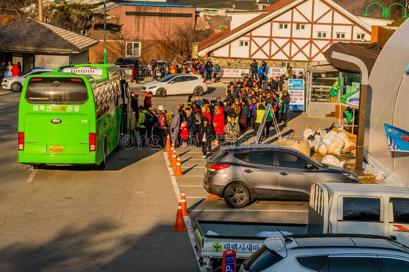 People wait in line to board bus stock photography